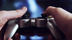 Playing videogame with a gamepad - stock footage