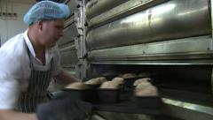 Baker Checking and Turning Bread in the Oven - stock footage