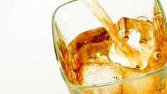 Top of view of  pouring whiskey on white background, whisky relax time Stock Footage