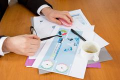 Close-up of graphs and charts analyzed by business people Stock Photos