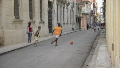 2 boys Practicing Soccer in Street - Havana Cuba - stock footage