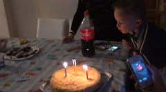 Birthday boy blows out candles Stock Footage