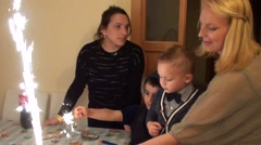Birthday boy blows out candles 2 Stock Footage