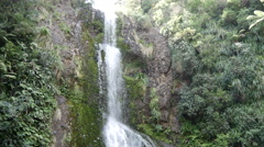 Time lapse from Kitekite Falls 3-tiered waterfall Stock Footage