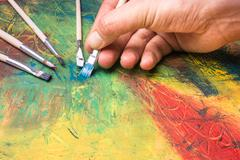 Painting of abstract painting with paintbrushes Stock Photos