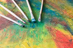 Painting of abstract painting with paintbrushes - stock photo