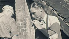 USA 1941: man smoking a cigar in a construction site - stock footage