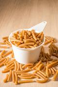 One Cup of Wholewheat Macaroni - stock photo