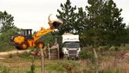 Stock Video Footage of Bulldozer dumping dirt into dump truck