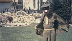 USA 1942: soldier taking his jacket out Stock Footage