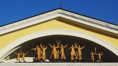 Art group of statues on theater fronton Stock Footage