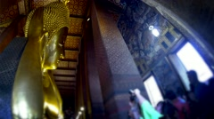 BANGKOK - March 2015: Reclining Buddha in Wat Pho Temple with tourists. 4K Stock Footage