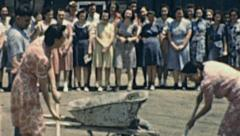 USA 1942: women workers digging a hole in the ground Stock Footage