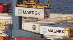 Carrying Maersk container in container terminal in port Stock Footage