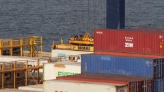 Reloading Maersk container with gantry crane in container terminal in port Stock Footage