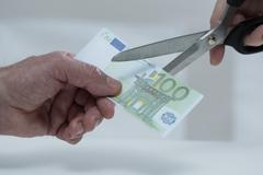 Cutting banknote Stock Photos