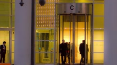 Entrance in building, whirligig people come into door Time lapse panorama - stock footage
