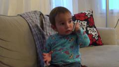 Stock Video Footage of Toddler listens phone attentively