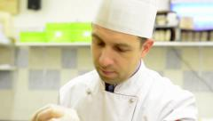 Chef gives dry pasta on stand - shot on chef Stock Footage