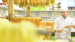 Chef gives dry pasta on stand  - after production Stock Footage