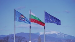 Flags of Bulgaria and EU were shaken wind in slow motion Stock Footage