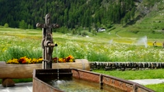 Small well in the Alps mountains Stock Footage