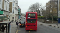 Number 49 red bus overtaking a small car - stock footage
