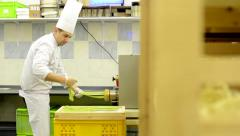 Chef makes pasta in factory - production of pasta - machine produce pasta Stock Footage