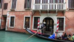 Gondola on a Venetian Canal in a Rainy Day. Includes the Song of the Gondolier. - stock footage