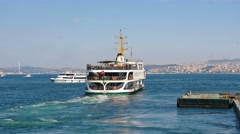 Bosphorus sightseeing tour ship leaving from old Istanbul Stock Footage