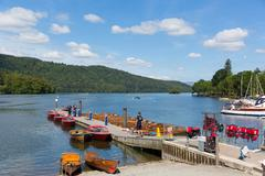 Pleasure boats and jetty Bowness on Windermere Cumbria UK - stock photo