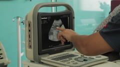 Pregnant Ultrasound Sonogram, Medical Equipment, Dr Points at Image - stock footage