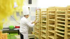 Chef gives pasta to rack - factory Stock Footage