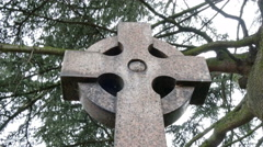 A circle with a cross tombstone in a cemetery Stock Footage