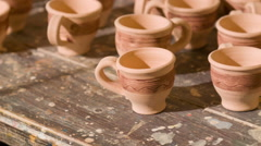 Many different cups made of loam Stock Footage