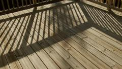 Stock Video Footage of Time Lapse Shadows Moving Across Wooden Deck in Back Yard