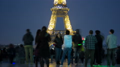 Eiffel Tower seen from Trocadero with crowd night timelapse in Paris, France Stock Footage