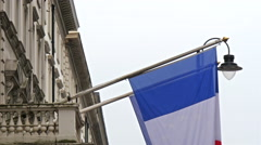 Flag of the country France is hanging on the terrace - stock footage