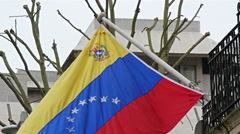 A Venezuelan flag waving on the pole in the terrace - stock footage