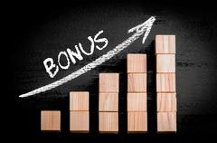 Word Bonus on ascending arrow above bar graph of Wooden small cubes isolated  - stock photo