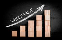 Word Wholesale on ascending arrow above bar graph of Wooden small cubes isola - stock photo