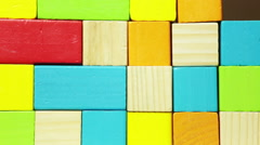 Human hand building wall from color wooden blocks Stock Footage