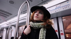 Thoughtful young woman in the subway car: standing, support, hand, pensive Stock Footage