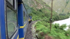 Stock Video Footage of Train trip in Peru to Machu Picchu alongside the river Urubamba