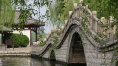 Chinese traditional arch bridge and pavilion Stock Footage