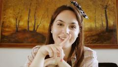young woman using webcam to chat with a friend or lover: perspective from webcam - stock footage