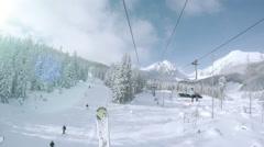 4K Footage: Ski lift in snowy Tatras Mountain resort Stock Footage
