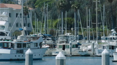 YACHTS IN A MARINA AWAIT THE RICH.  TIME LAPSE. Stock Footage