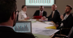 Business man asks questions to his team during a meeting. In slow motion. Stock Footage