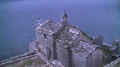 old stone church on island by the sea full hd 2 - stock footage